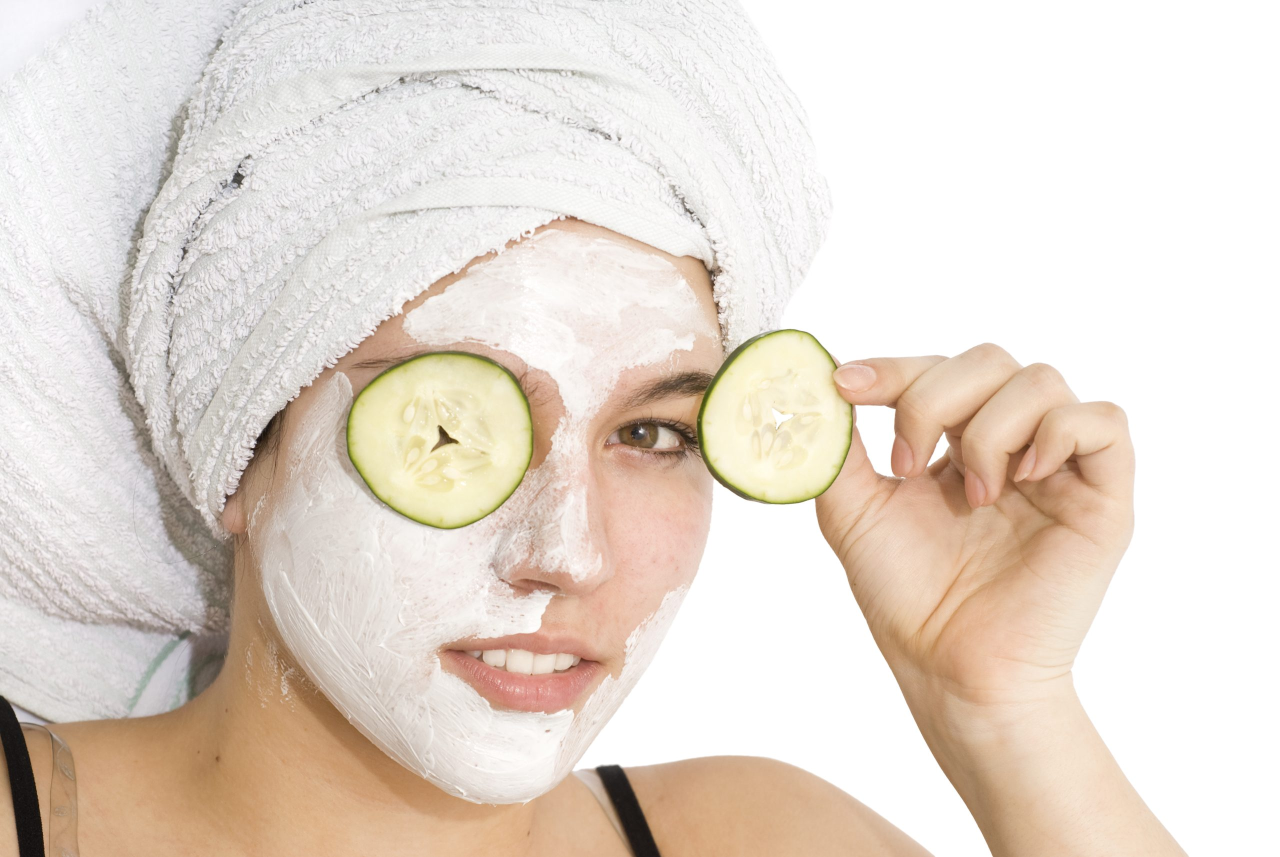 Anti-Aging Beauty Secrets with Girl wearing face moisture mask with cucumbers over her eyes.