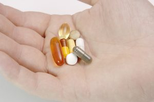 Handful of Supplements, vitamins and medicine. Free photo 3029634 © Neil Speers - Dreamstime.com